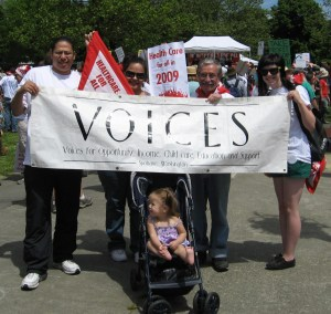 Raymond, Anna, Jim, and Erica holding the VOICES Banner